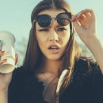 hipster woman with cup of coffee