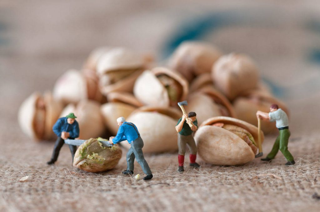 Toy figures of lumbermen with a peanut